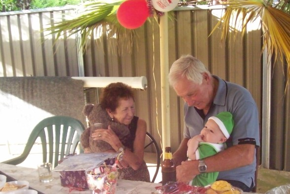 My mum and step dad sitting on patio celebrating Christmas day in 2011